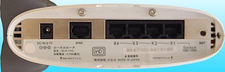 写真1 メルコ「BLR-TX4」の背面写真。左にWAN側ポートが、右にLAN側ポートが4つ並んでいるのが分かる