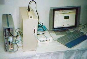 写真1:PC本体より大きかった2001年のPLCアダプタ