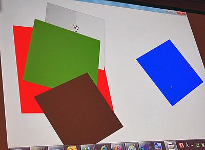 赤、青、緑、茶色、ボタンをマニピュレーションするデモ