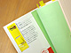 ポスト・イットのディスペンサーを読みかけの本に直接つける