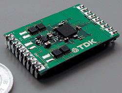 図4 TDKが「スイッチング電源システム展2002」で公表した、フルデジタルICを搭載したPOLコンバータ。ICはオリジナルのカスタム品。