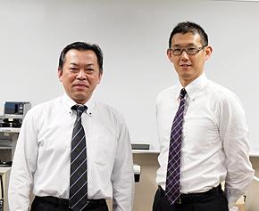 金沢市 市長公室 情報政策課 ICT推進室の松田俊司室長(左)と、神田現主任理事