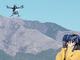 """南阿蘇の雄大な景色を360度VRライブ映像で""""飛行体験"""" 5GドローンとVRゴーグルを活用——KDDIら、VR観光の実証実験"""