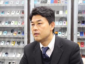 KDDI 財務・経理部長 西田圭一氏