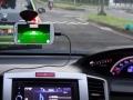 渋滞抑制アプリを搭載したスマートフォンを車両内に設置した状態