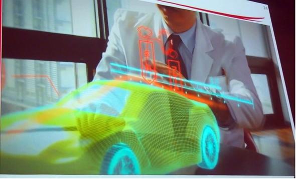 図12 バーチャルな車両を前にしてデザイナーと設計者が打ち合わせする様子【2】(出典:理化学研究所 計算科学研究センター)