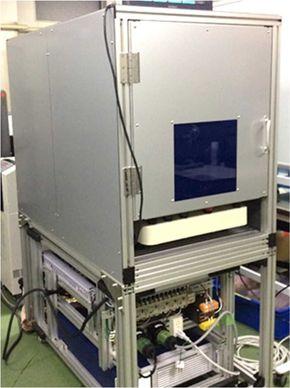 JSTが新開発したフラットパネル用の溶着機[クリックして拡大]出典:JST