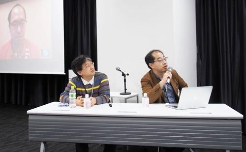 広報部 技術広報担当課長の堂前清隆氏は自宅からテレビ電話で参加