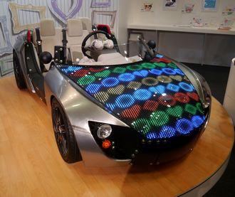 描いた絵が車のボンネットに 「東京おもちゃショー」トヨタブースで痛車デザインを楽しもう ねとらぼ