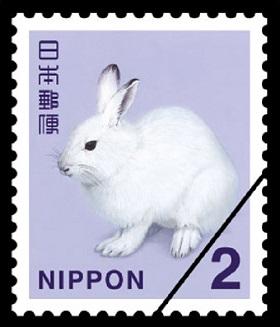 2円切手まみれのゆうパック