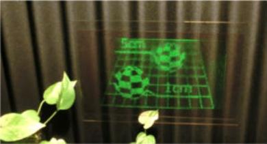 透明な光学スクリーンに投影されたホログラム映像