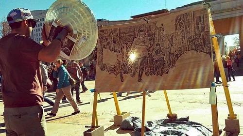 レンズで太陽光を集熱させて描くアート