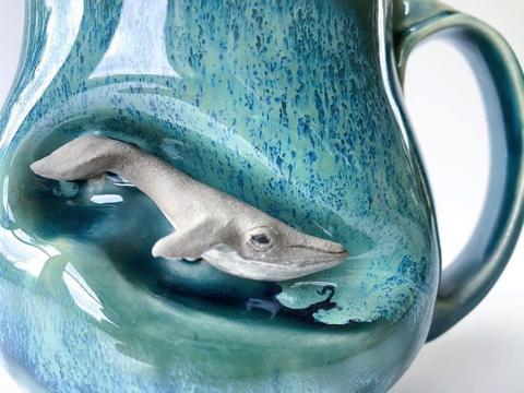 マグカップに籠る動物
