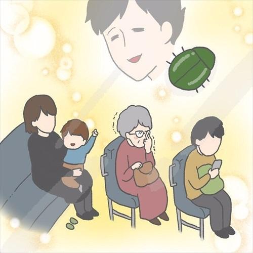 カナブンを指さす赤ちゃん