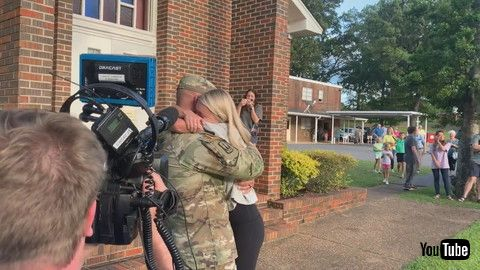 「Girl Hugs Military Dad While Crying When He Surprise Visits Before Graduation Ceremony - 1199663-3」
