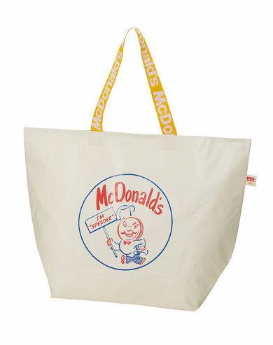 創成期のキャラクター「スピーディー」とマクドナルドの象徴スマイルがデザインされた「ビッグスマイルバッグ」