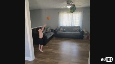 「Kid Performs Cool Trick Shots By Putting Different Balls Through Mini Basketball Hoop - 1186085」