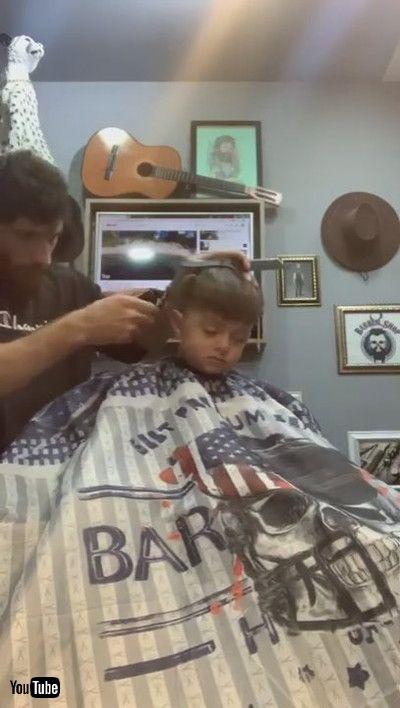 「Little Boy Falls Asleep While Getting His Hair Cut By Barber - 1200925」
