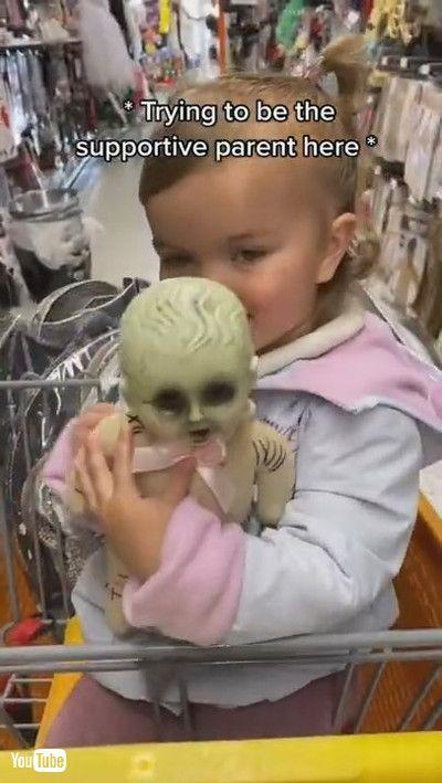 「Little Girl Loves Her Halloween Baby Doll    ViralHog」
