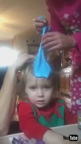 「Parents Try to Remove Blue Slime Stuck in Kid's Hair - 1212521」