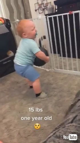 「Toddler Lifts Fifteen-Pound Heavy Medicine Ball by Himself - 1229660」