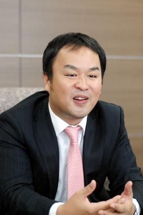 スーパーストリーム マーケティング企画部 部長 山田 誠氏。現在、スーパーストリームはキヤノン MJ ITグループの傘下にあり、グループ内の企業とも協力している
